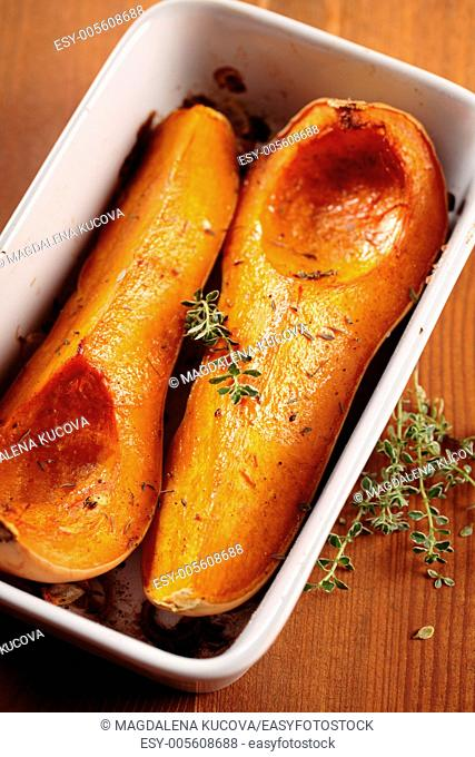 Tray with baked butternut squash and herbs