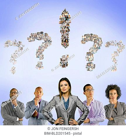 Business people with question marks above their heads