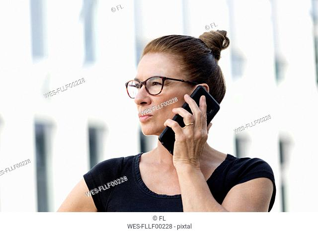 Portrait of woman on cell phone outdoors