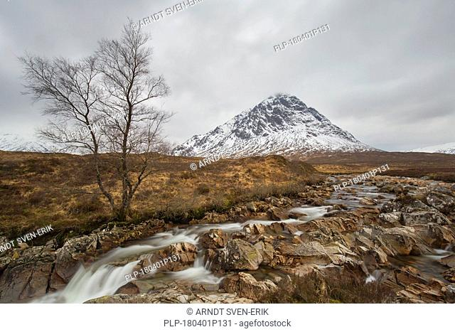 Scottish mountain Buachaille Etive Mòr and waterfall on River Coupall in winter in Glen Etive near Glencoe in the Highlands of Scotland, UK