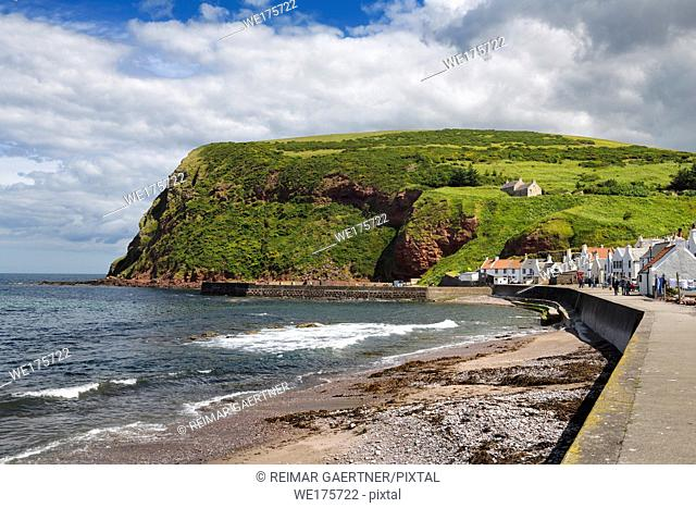 Shore of Pennan coastal fishing village in Aberdeenshire Scotland UK featured in film Local Hero