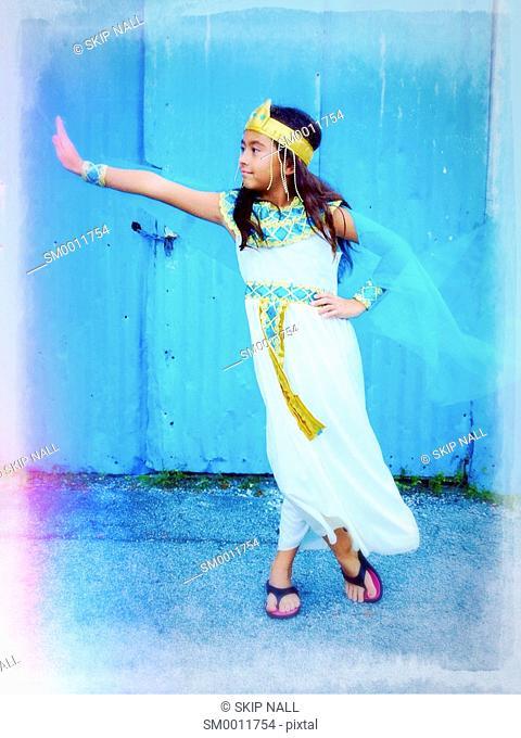 A little girl wearing a Cleopatra dress