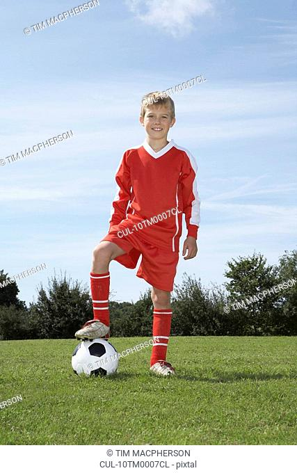 Young Male footballer with a ball