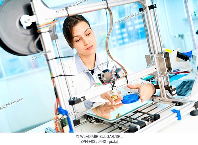 Technician working on 3D printer