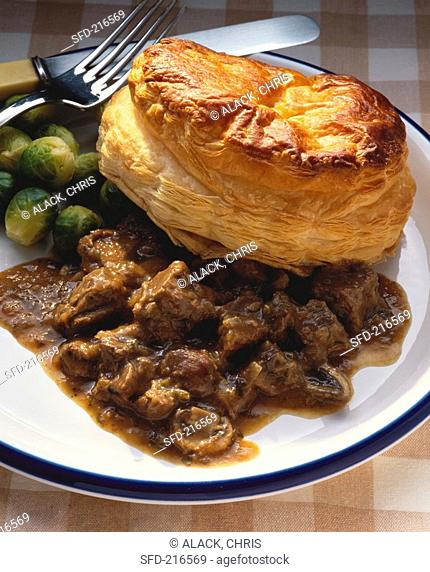 Beef stew with puff pastry and Brussels sprouts