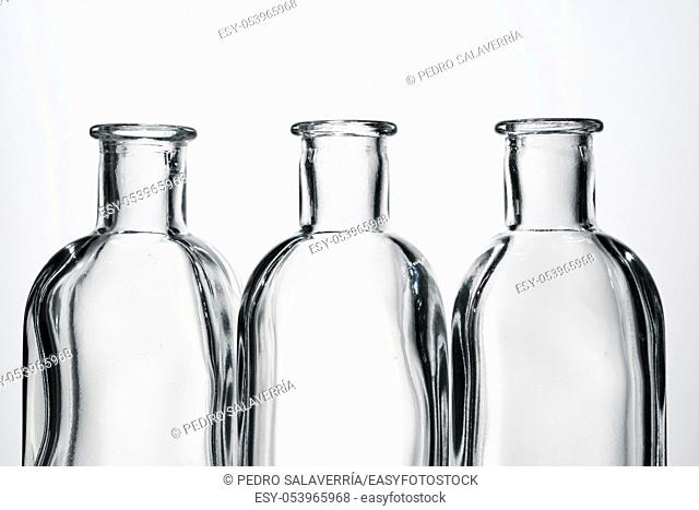 Glass bottles and white background