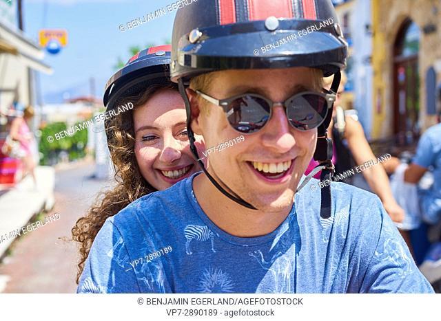 happy young couple enjoying road trip. Hersonissos, Crete, Greece