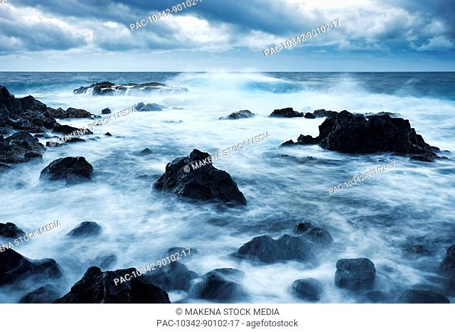 Hawaii, Maui, Kipahulu, Dramatic stormy ocean coastline at sunrise