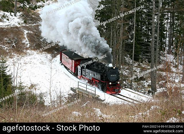 13 February 2020, Saxony-Anhalt, Wernigerode: A train of the Harzer Schmalspurbahnen GmbH (HSB) runs on the line towards Drei-Annen-Hohne