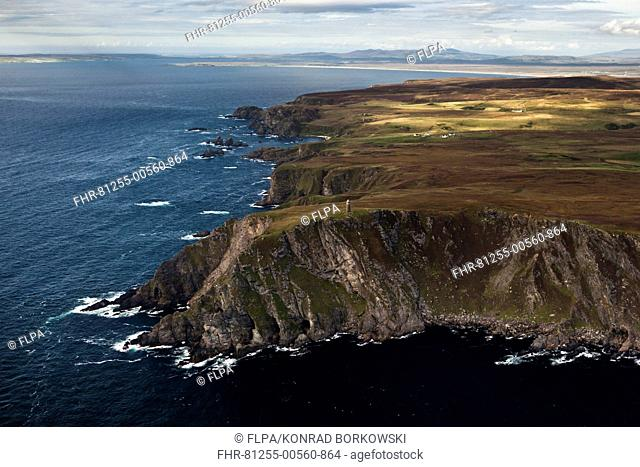 Aerial view of coastline with cliffs and commemorative monument, American Monument, Mull of Oa, Islay, Inner Hebrides, Scotland