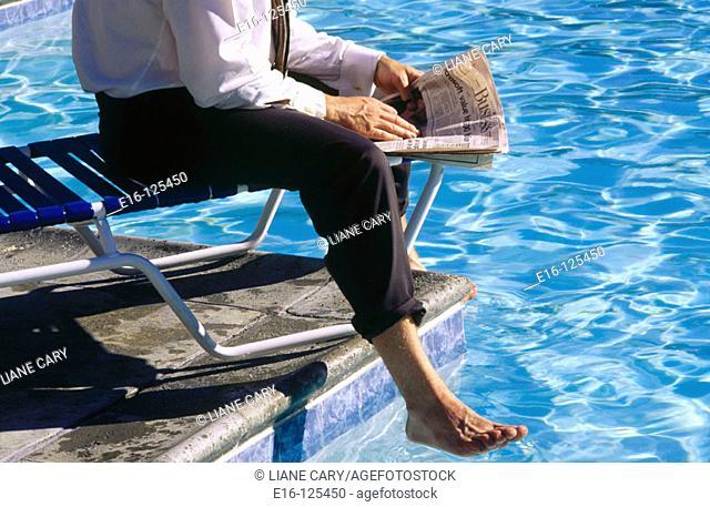 Businessman at poolside