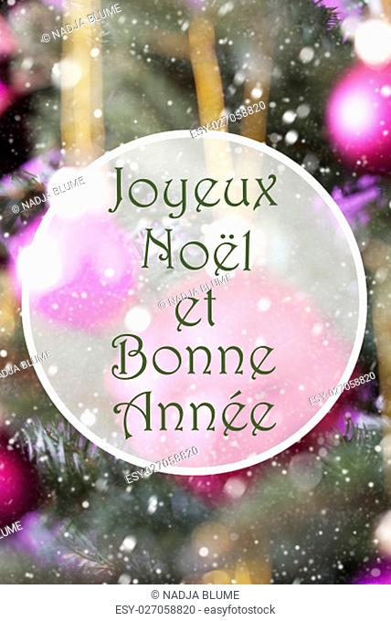 French Text Joyeux Noel Et Bonne Annee Means Merry Christmas And Happy New Year. Vertical Christmas Tree With Rose Quartz Balls