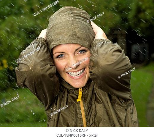 A woman in the rain smiling