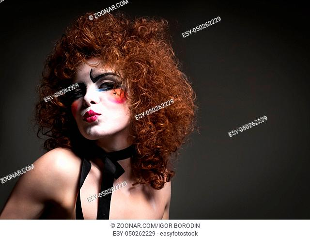 Woman mime with theatrical makeup. Studio shot