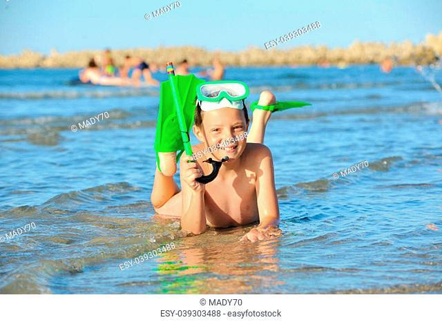 boy in the sea on a beach