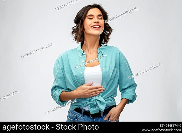 happy full young woman touching her tummy