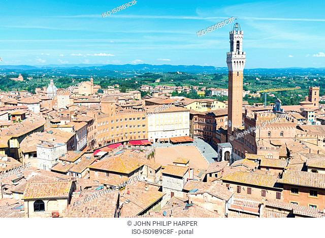 Cityscape view of rooftops and Torre del Mangia, Siena, Tuscany, Italy