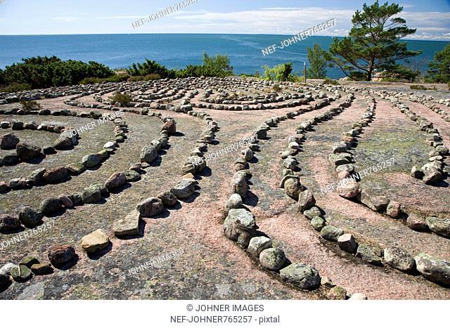 A labyrinth of stones on a flat rock
