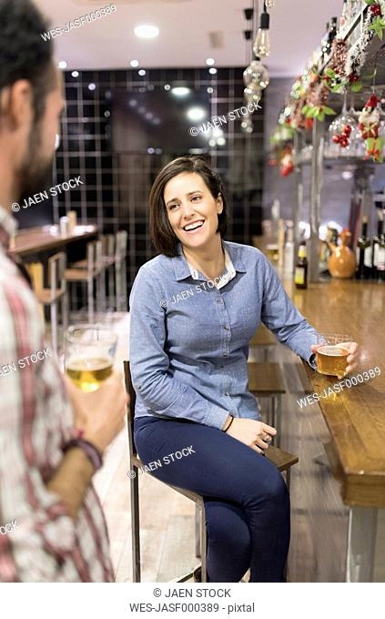 Woman and man socializing in a bar