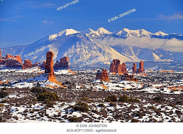 Sandstone spires and La Sal Mpuntains in winter, Arches National Park, Utah, USA