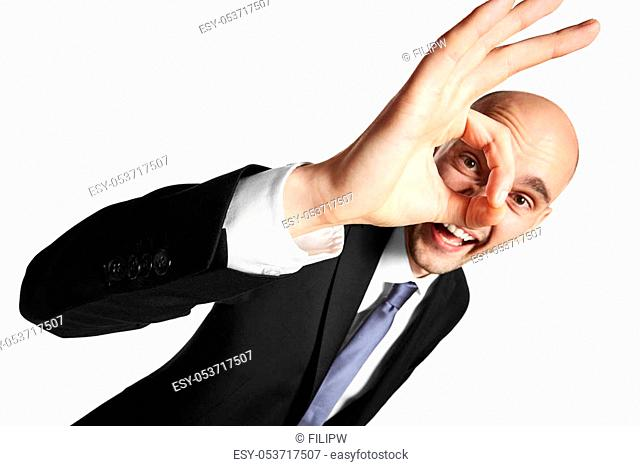 Studio shot of young happy businessman. Isolated on white background