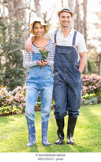 Portrait of smiling couple gardening
