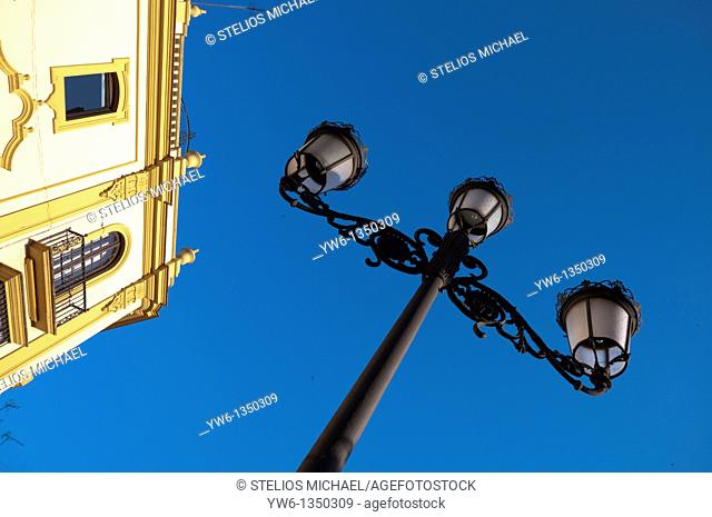 Ornate Lampost and Building in Building Plaza Virgen de los Reyes in Central Seville,Spain