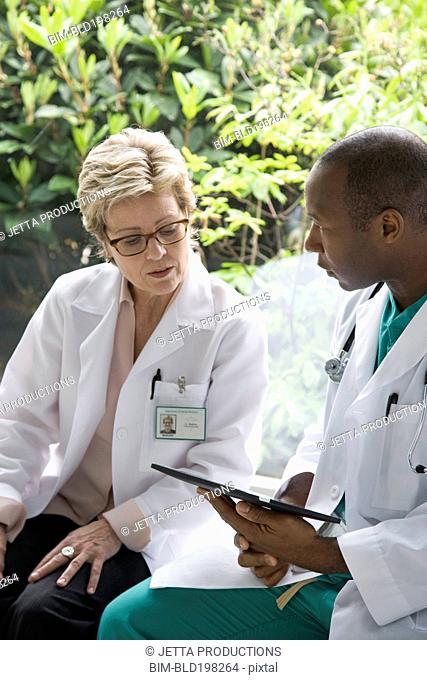 Doctors looking at digital tablet together