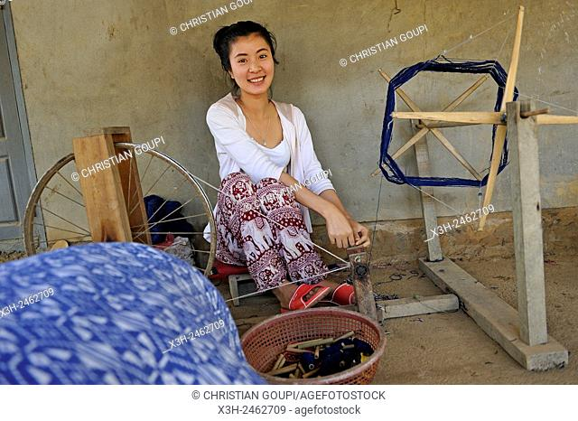 woman making reel of cotton thread, village around Nong Khiaw, District of Luang Prabang, Northern Laos, Southeast Asia