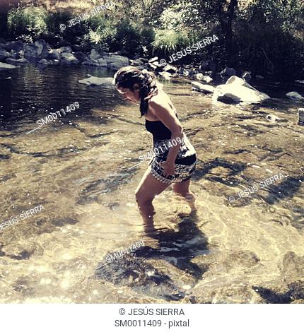Girl in Charco los Pielagos, Navaluenga, Alberche river, Avila province, Spain