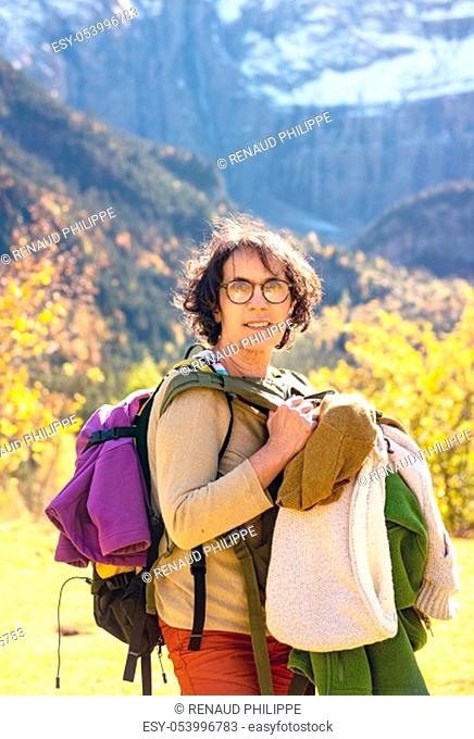 a portrait of mature woman hiker in the mountain with backpack