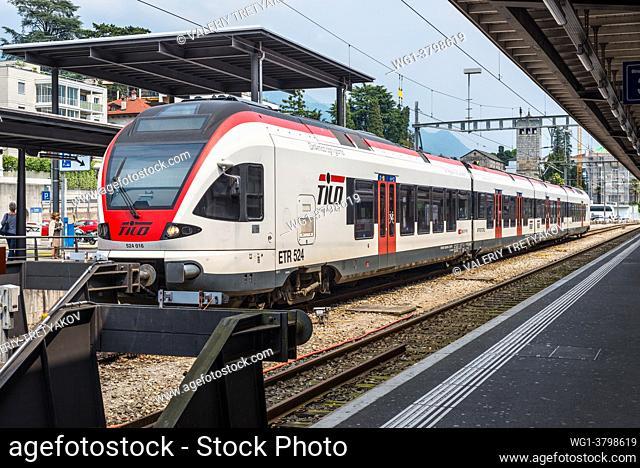 Bellinzona, Switzerland A passenger train of the TILO (Regional Train Ticino Lombardia) at a platform of the Bellinzona railway station