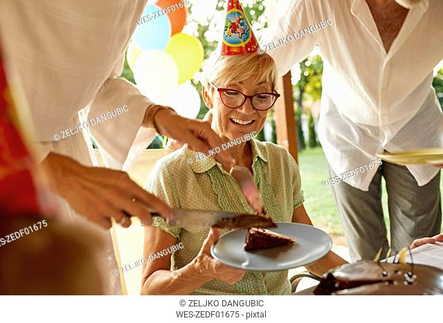 Serving cake on a birthday garden party