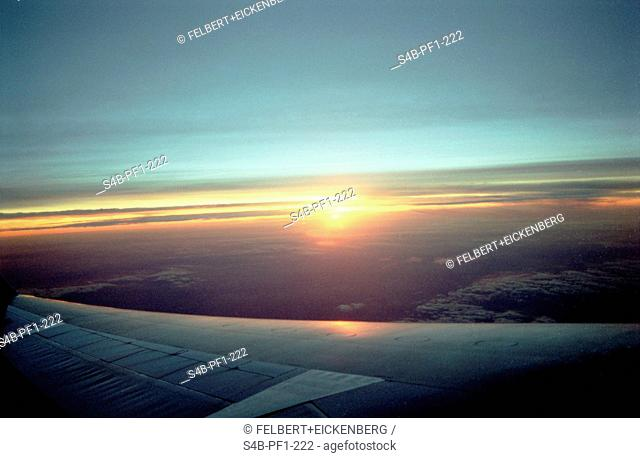 View out of a Plane with wing - Sunset