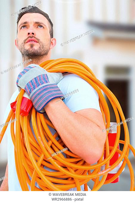 Electrician with wires cables on building site