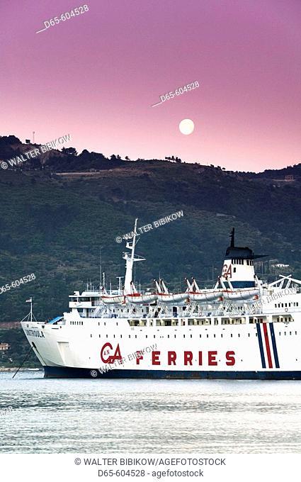 Greek Island Ferry with Moonset. Dawn. Vathy (Samos town). Samos. Northeastern Aegean Islands. Greece