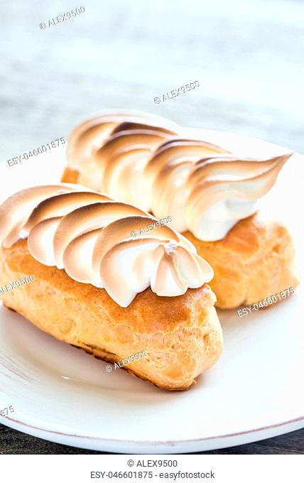Eclairs with lemon curd and meringue