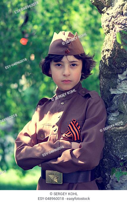 Portrait of a boy in the uniform of a soldier of the Red Army during the Second World War. Stylization. Retro toning