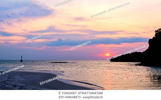 Beautiful nature landscape of colorful the sun on the sky at Tarutao island beach during the sunset over the Andaman Sea, Tarutao National Park, Satun, Thailand