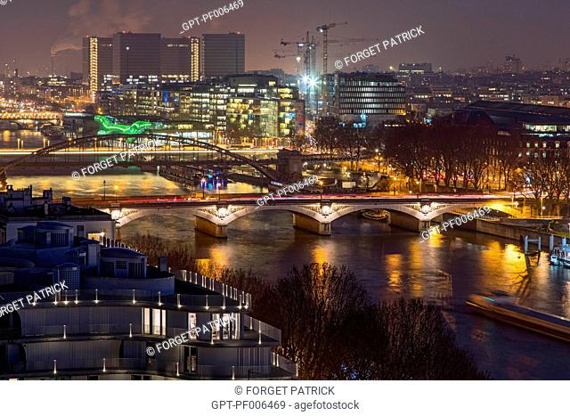 THE QUAYS OF THE SEINE AT NIGHT, THE FRANCOIS MITTERRAND LIBRARY AND THE IVRY QUAY SEEN FROM THE PAVILION OF THE ARSENAL, PARIS (75), FRANCE