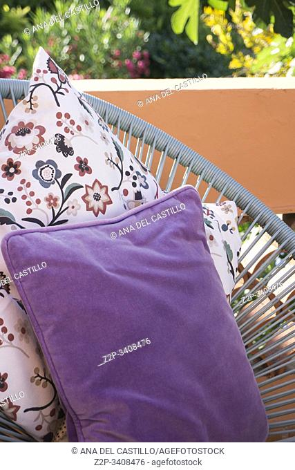 Colorful cushions in Mediterranean patio Alicante Spain