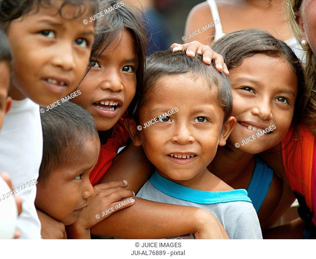 View of a group of children hugging each other, Curiapo, Orinoco, Venezuela