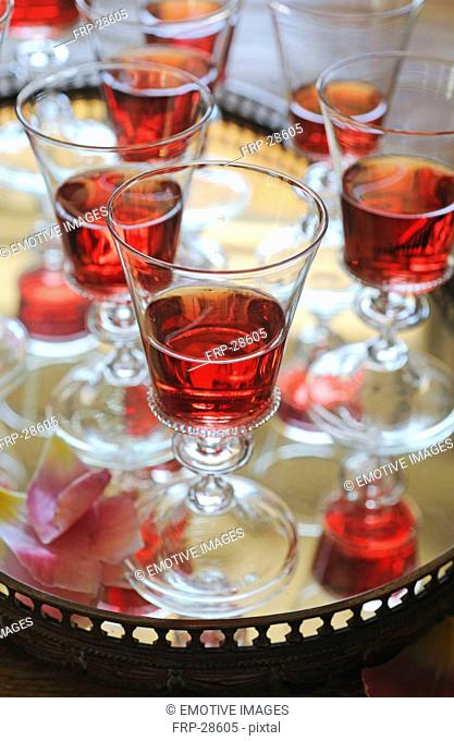 Glasses of red wine on tray