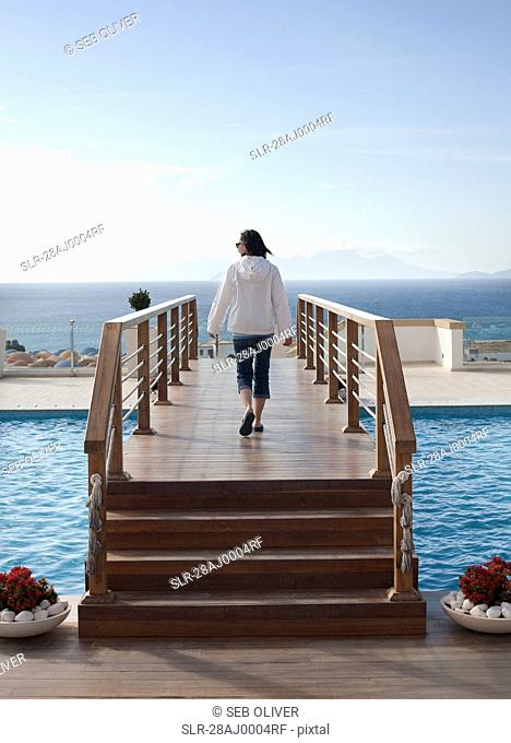 Woman walking over bridge