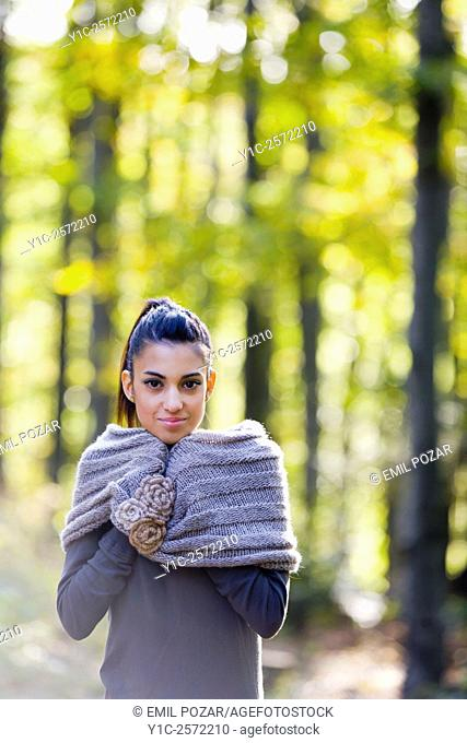 Mulatto teen girl in forest