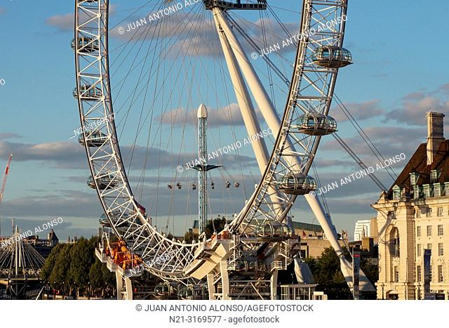 The London Eye and a partial view of the County Hall on Queen's Walk. On the left, a small part of the Hungerford and the Golden Jubilee bridges over the river...
