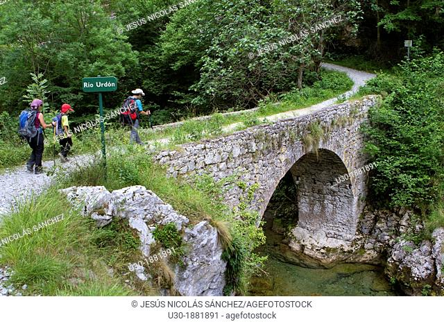 Hikers walking down from Tresviso, a small village in Picos de Europa National Park by historic Urdón path to La Hermida Gorges  Peñarrubia  Cantabria, Spain