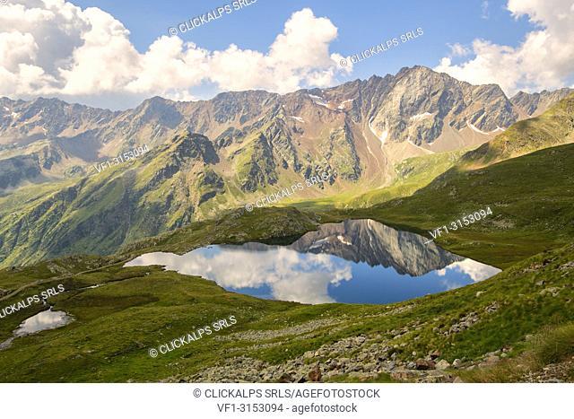 Pietrarossa reflected in the black lake, Gavia pass, Lombardy district, Italy, brescia province