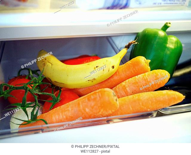 Vegetables and fruits in a fridge