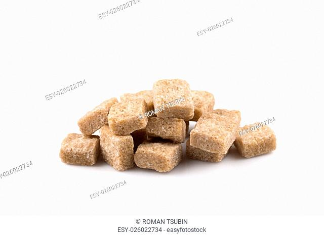 brown sugar cubes isolated on a white background